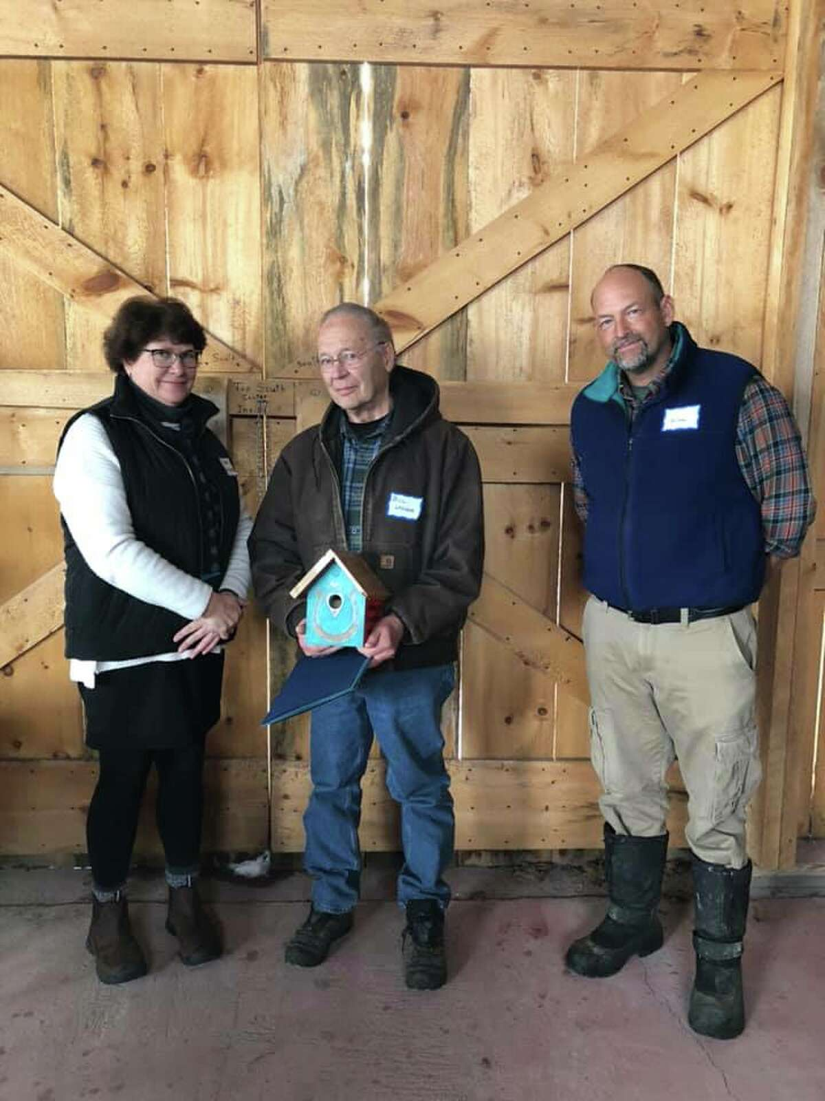 From left, Sue Ginouves, Bill Lasher and Saratoga PLAN chair Will Orthwein celebrate Conservation Heroes.