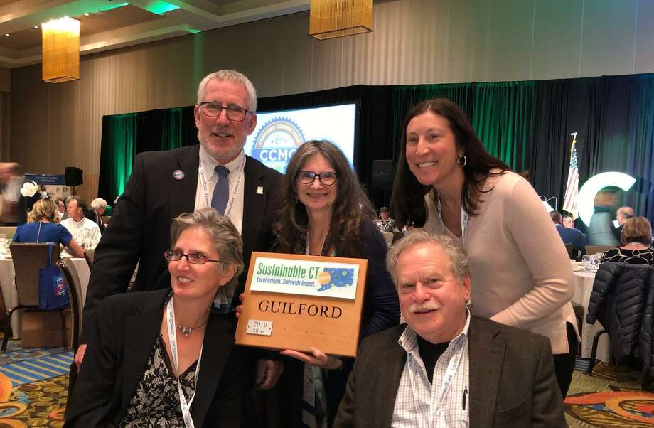 Guilford was awarded a plaque for earning a silver certification from Sustainable CT at a Connecticut Conference of Municipalities event this month. Top left is First Selectman Matthew T. Hoey III. Photo: Town Of Guilford / Contributed Photo