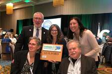 Guilford was awarded a plaque for earning a silver certification from Sustainable CT at a Connecticut Conference of Municipalities event this month. Top left is First Selectman Matthew T. Hoey III.
