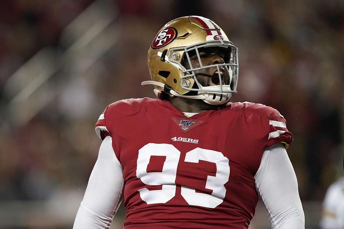 San Francisco 49ers defensive tackle D.J. Jones (93) yells during the first half of an NFL football game against the Green Bay Packers in Santa Clara, Calif., Sunday, Nov. 24, 2019. (AP Photo/Tony Avelar)