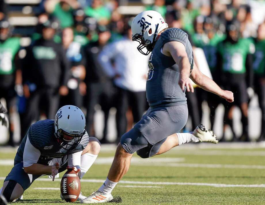 Chris Barnes of the Rice Owls kicks a 21 yard field goal out of the hold of Adam Nunez (29) during the second quarter against North Texas in November. Photo: Bob Levey, Stringer / Getty Images / 2019 Getty Images
