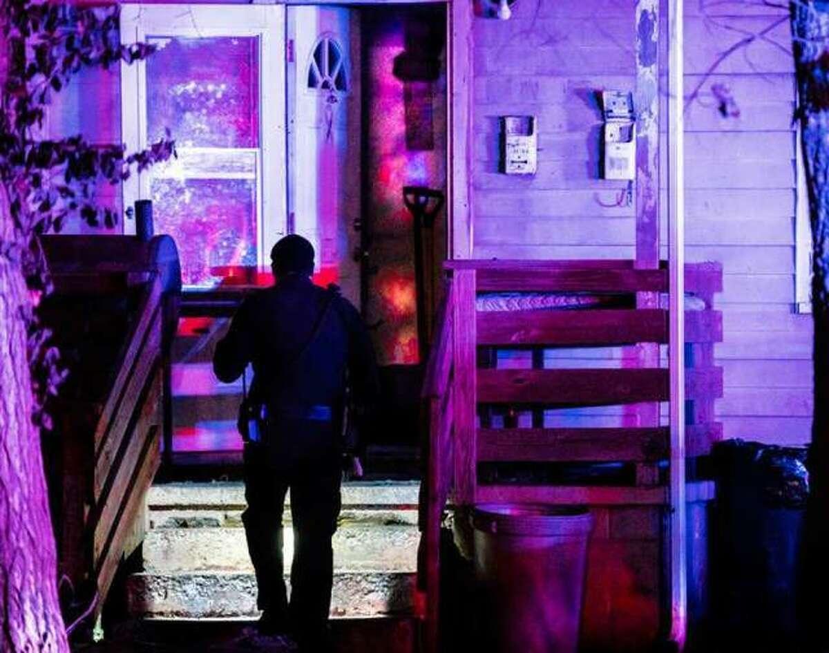 An Alton police officer on the scene Nov. 29, 2018 of the stabbing death of John Jackson.