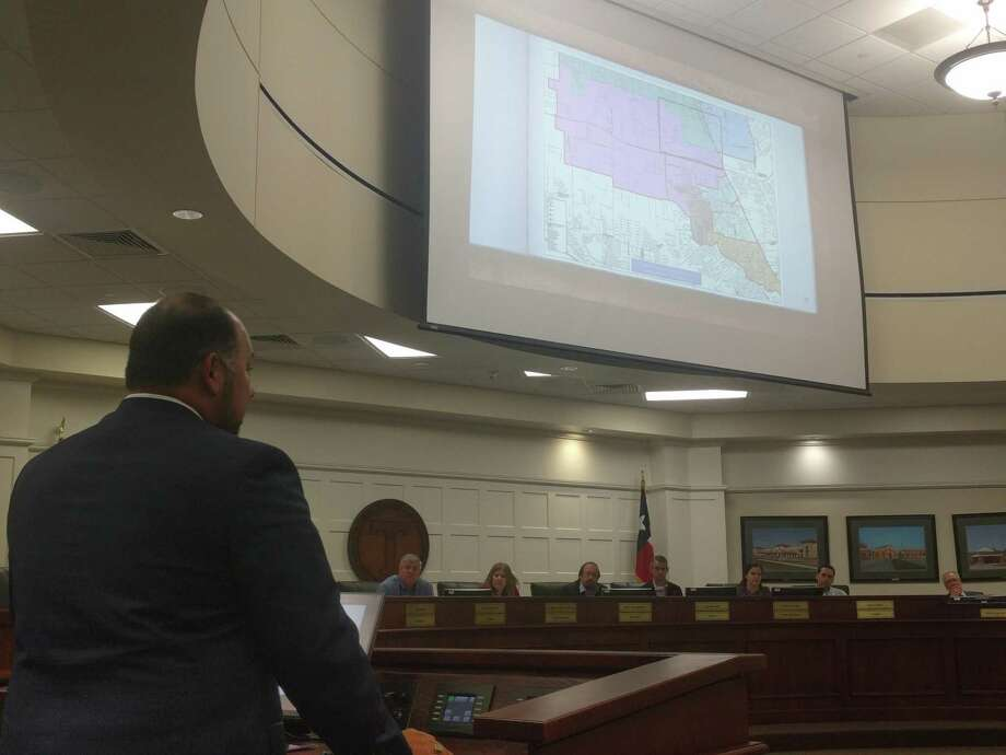 Tomball ISD Chief Operating Officer Steven Gutierrez talks with board members about the updating zoning districts for the new elementary and junior high schools. Photo: Paul Wedding