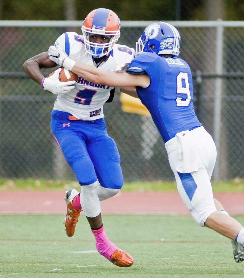 Danbury's Pierre Moudourou tries to break away from Darien's Finlay Collins in a game played in 2015. Photo: Scott Mullin / For Hearst Connecticut Media / The News-Times Freelance