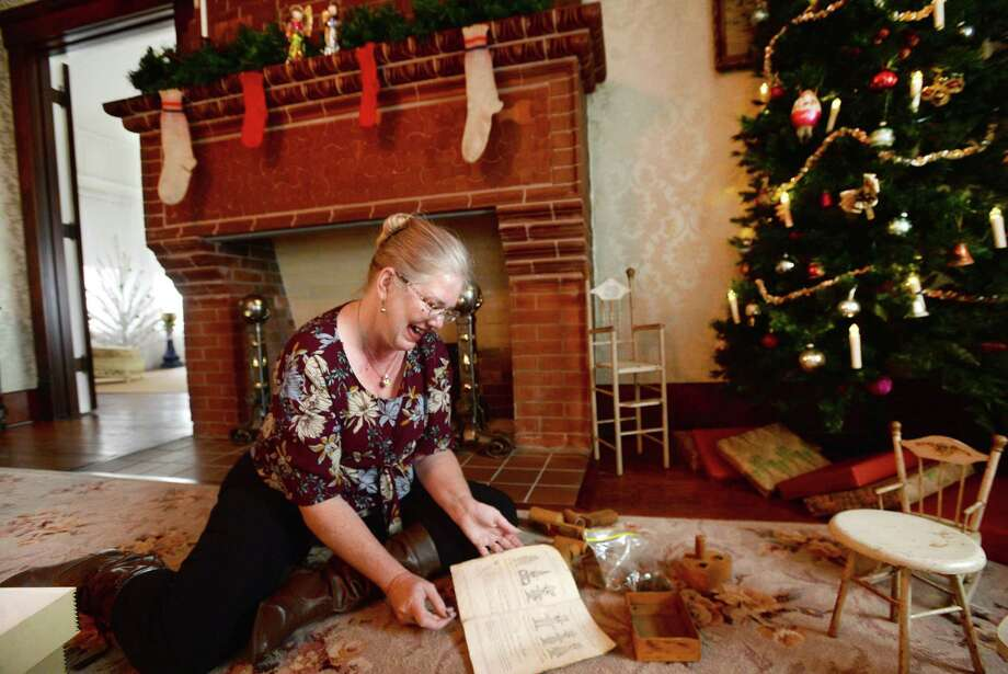 """Beaumont Heritage Society's Chevelle Thomas reacts as she puts together the Christmas tree gift display at the Chambers House Museum as she and co-member Melanie Karr finish the holiday decorations at the historic home in anticipation of the annual holiday tour Dec. 12. Thomas says they try to change up the decor for the yearly event to showcase the variety of family holiday heirlooms that fill their storage unit. """"We're still finding new things,"""" she says. Putting together one of the children's toys beneath the tree - the wooden Deedle-Dum set - Thomas says she felt like she was one of the Chambers girls at Christmas. Photo taken Tuesday, November 26, 2019 Kim Brent/The Enterprise Photo: Kim Brent / The Enterprise / BEN"""