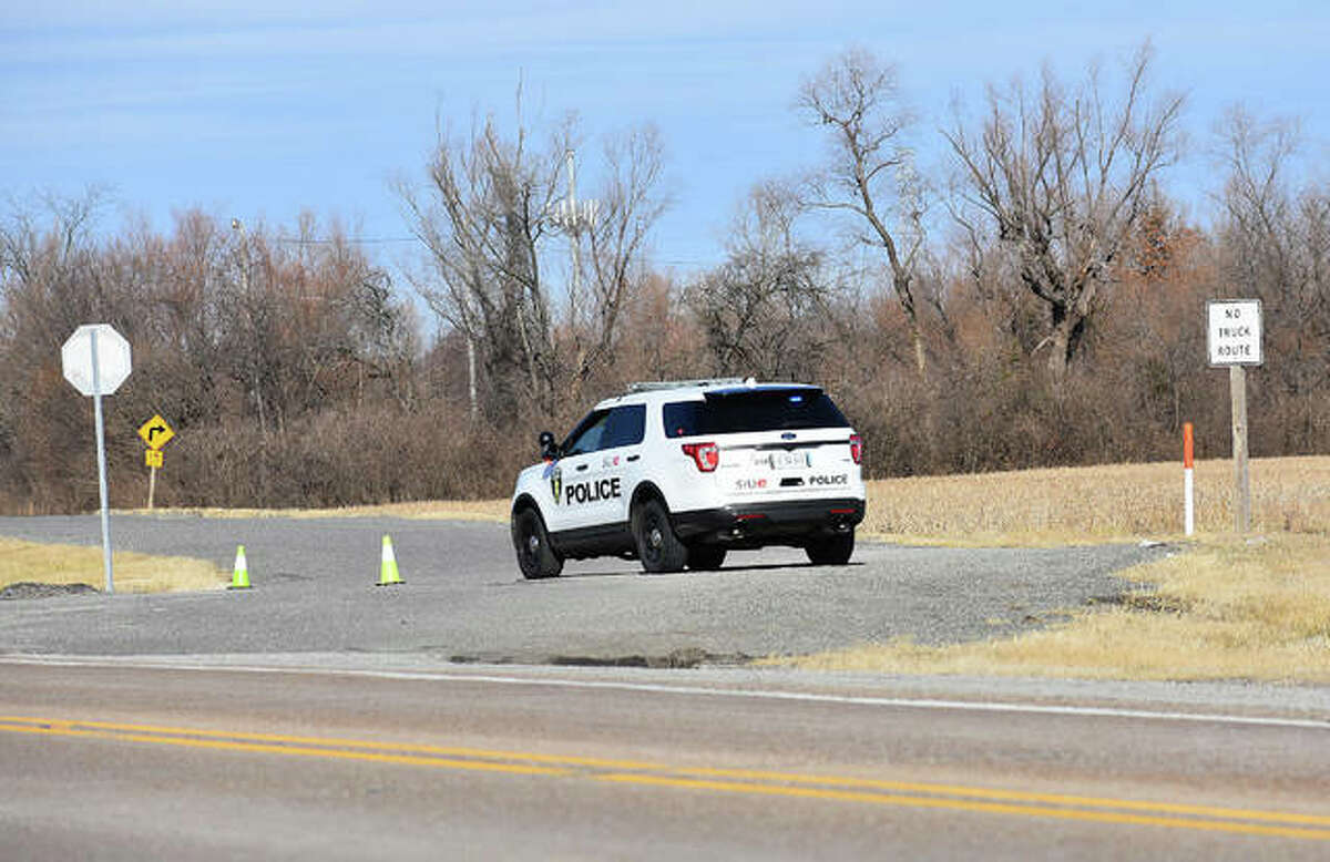 An SIUE police car blocks traffic from entering onto Poag Road from Route 111.