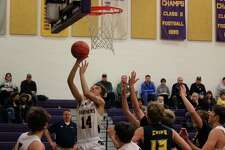 Luke Hammon scores on a layup in the first quarter against Manistee. (Photo/Robert Myers)