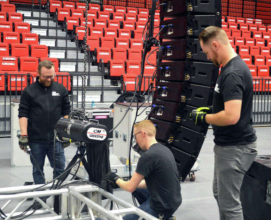 Workers prepare the audio system and the stage in the First Community Arena at the Vadalabene Center for the SIUE fall commencement, which will have three sessions at 2 p.m. Friday, 9 a.m. Saturday and 1 p.m. Saturday. Photo: Scott Marion/The Intelligencer