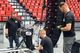 Workers prepare the audio system and the stage in the First Community Arena at the Vadalabene Center for the SIUE fall commencement, which will have three sessions at 2 p.m. Friday, 9 a.m. Saturday and 1 p.m. Saturday.