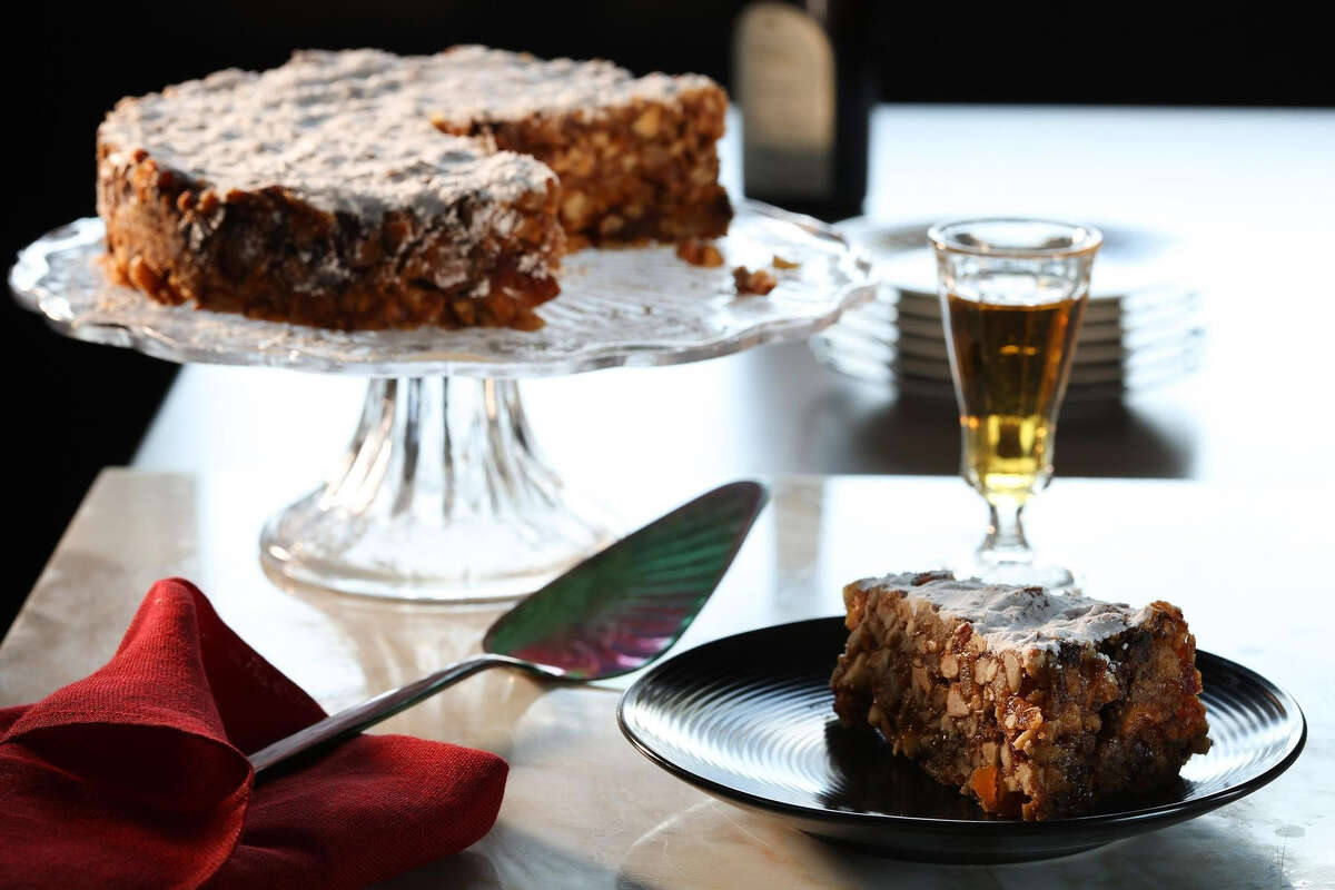 Panforte is a traditional Italian sweet, said to be invented in Siena, filled with nuts, dried fruits and spices. A glass of vin santo (which means holy wine) makes a beautiful companion. (Abel Uribe/Chicago Tribune/TNS)