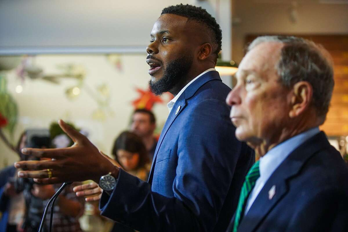 Former Mayor of New York and presidential candidate Michael Bloomberg listens as Mayor of Stockton Michael Tubbs speaks to the community at Trail Roasters Coffee shop in Stockton, California, on Wednesday, Dec. 11, 2019.
