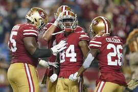 San Francisco 49ers wide receiver Kendrick Bourne (84) celebrates with teammates after scoring against the Seattle Seahawks during the first half of an NFL football game in Santa Clara, Calif., Monday, Nov. 11, 2019. (AP Photo/Tony Avelar)