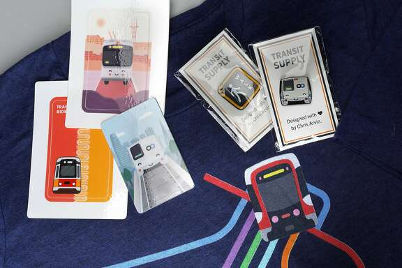 Artist/designer Chris Arvin shows his transit themed card covers, pins and apparel seen on Wednesday, Dec. 4, 2019, in San Francisco, Calif.