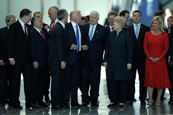 In this 2017 photo, Montenegro Prime Minister Dusko Markovic, center right, smiles after appearing to be pushed by U.S. President Donald Trump during a NATO summit. A reader says Trump may not have the best diplomacy skills.