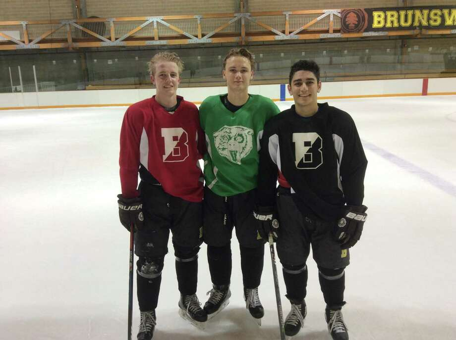 From left to right, Connor Sullivan, Henry Foster and Shayan Farjam are senior captains of the Brunswick School hockey team. Photo: David Fierro /Hearst Connecticut Media