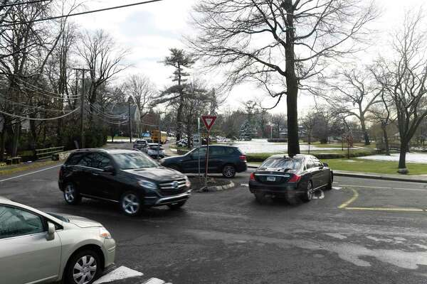 Traffic passes through the roundabout at the intersection of Sound Beach Avenue and Laddins Rock Road bordering Binney Park in Old Greenwich, Conn. Wednesday, Dec. 11, 2019. The Eastern Greenwich Preservation Association is trying to get a scenic road designation from the town to protect this section of road from potential DPW projects.
