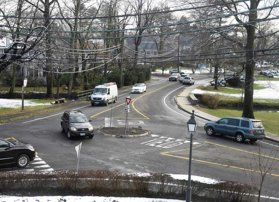 Traffic passes through the roundabout at the intersection of Sound Beach Avenue and Laddins Rock Road bordering Binney Park in Old Greenwich, Conn. Wednesday, Dec. 11, 2019. The Eastern Greenwich Preservation Association is trying to get a scenic road designation from the town to protect this section of road from potential DPW projects. Photo: Tyler Sizemore / Hearst Connecticut Media / Greenwich Time
