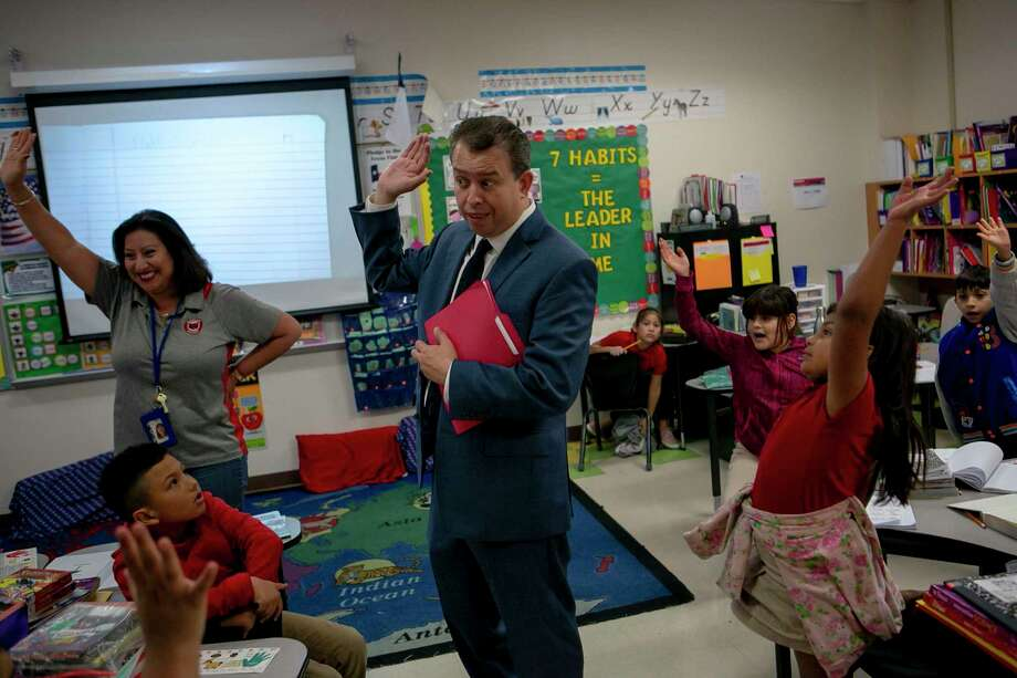 SAISD Superintendent Pedro Martinez visits a class of second graders at Hawthorne Academy last fall. Finally, people are awaking to the value of educators, but as an investment in our future and potential or as daycare? Photo: Josie Norris /The San Antonio Express-News / **MANDATORY CREDIT FOR PHOTOG AND SAN ANTONIO EXPRESS-NEWS/NO SALES/MAGS OUT/TV