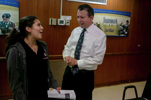 Martinez laughs with Fox Tech High School representative Kristi Jimenez after the meeting with the student advisory panel.