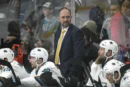 San Jose Sharks head coach Peter DeBoer, center, during an NHL hockey game against the Los Angeles Kings, Monday, Nov. 25, 2019, in Los Angeles. (AP Photo/Michael Owen Baker)