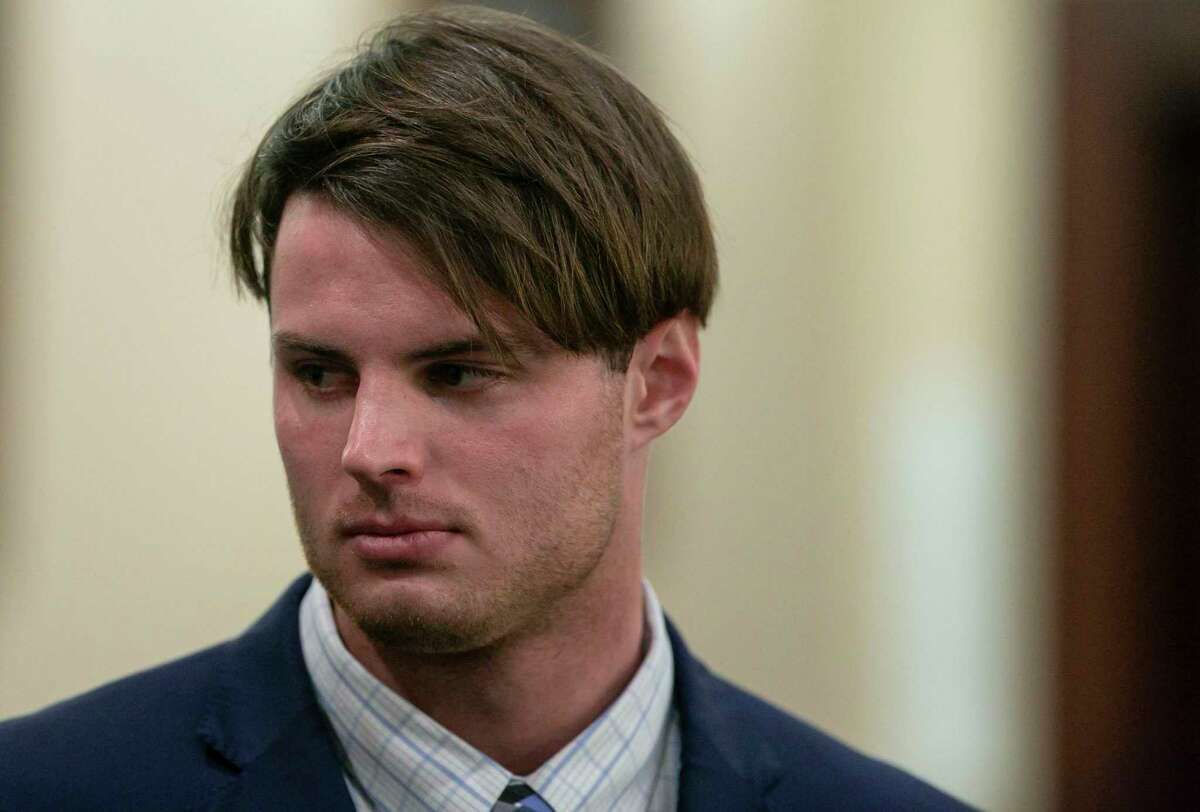 Mark Howerton, 24, accused in the death of his girlfriend, Cayley Mandadi, stands as the jury recessed for the day following deliberations on Wednesday, Dec. 11, 2019.