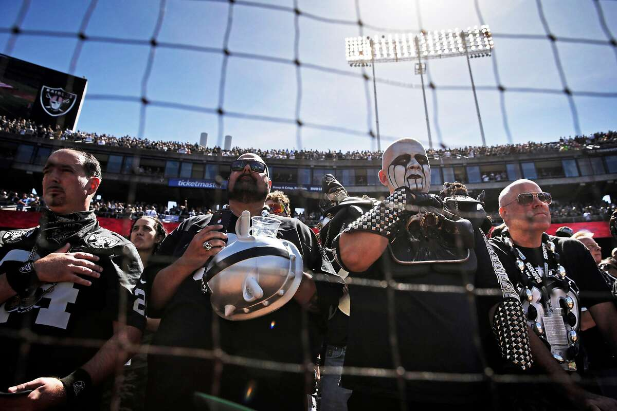 Raiders fans show their respect during the national anthem before the Oakland Raiders played the Kansas City Chiefs in the coliseum in Oakland, Calif., on Sunday, September 15, 2019.