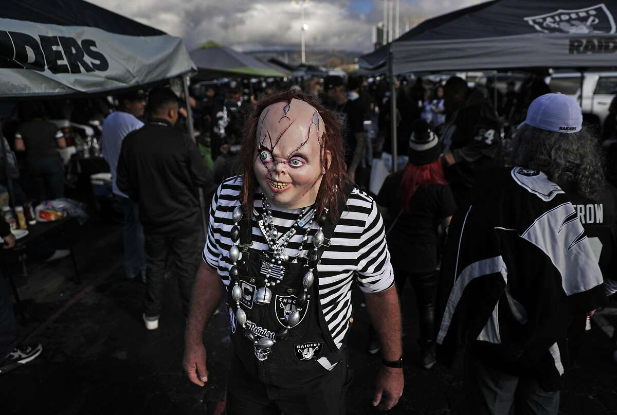 Kent Smith of Sausalito dressed up as Chuckie, tailgates in the parking lot before the Oakland Raiders played the Tennessee Titans at Coliseum in Oakland, Calif., on Sunday, December 8, 2019. Sunday's game will be the second to the last game at the Coliseum before the team departs for Las Vegas next season.