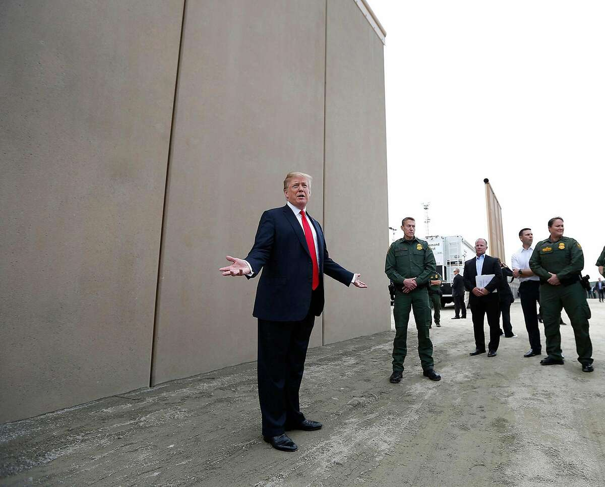 President Donald Trump tours the border wall prototypes near the Otay Mesa Port of Entry in San Diego County, Calif., on March 13, 2018. (K.C. Alfred/San Diego Union-Tribune/TNS)