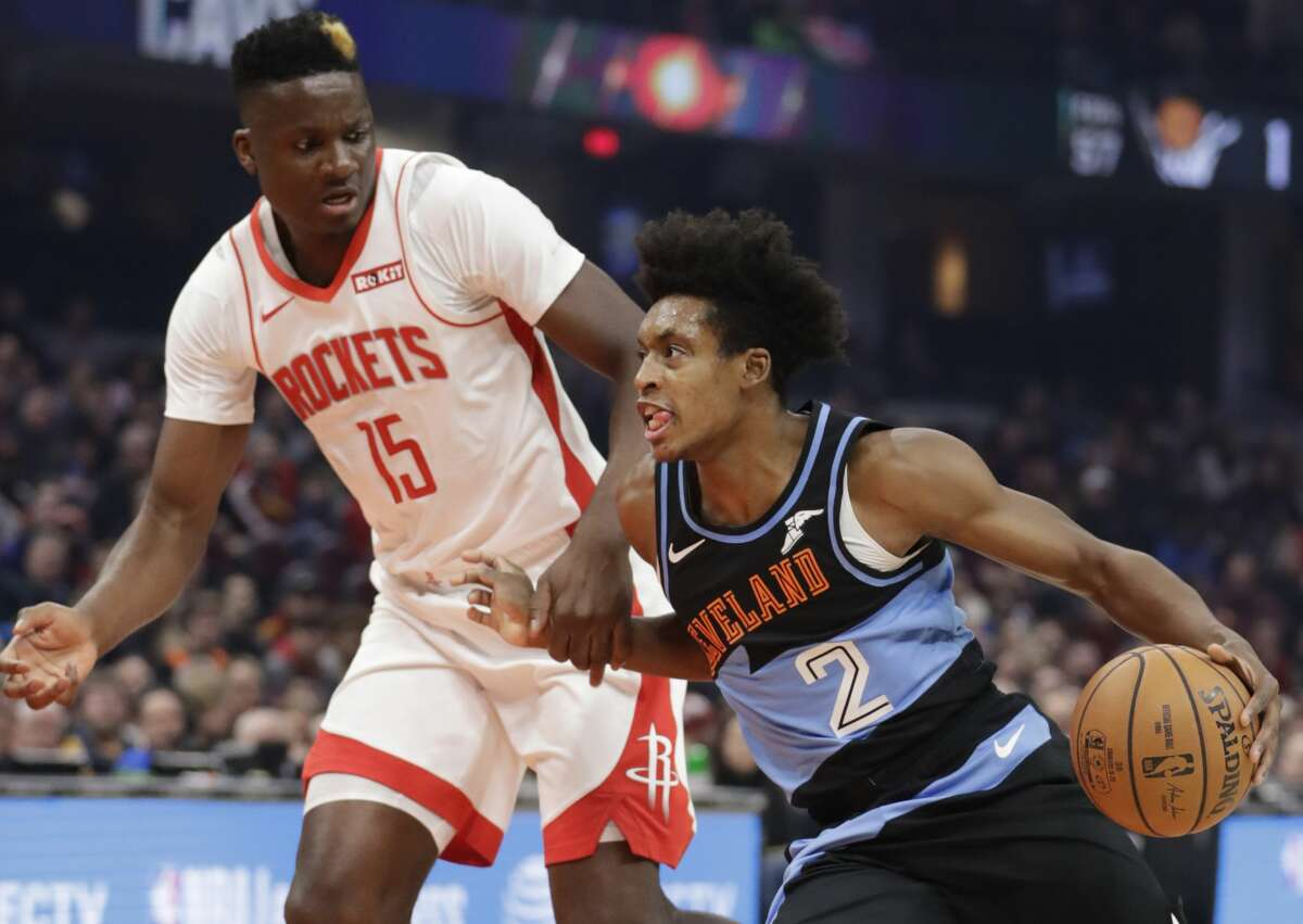 Cleveland Cavaliers' Collin Sexton (2) drives past Houston Rockets' Clint Capela (15) in the first half of an NBA basketball game, Wednesday, Dec. 11, 2019, in Cleveland. (AP Photo/Tony Dejak)