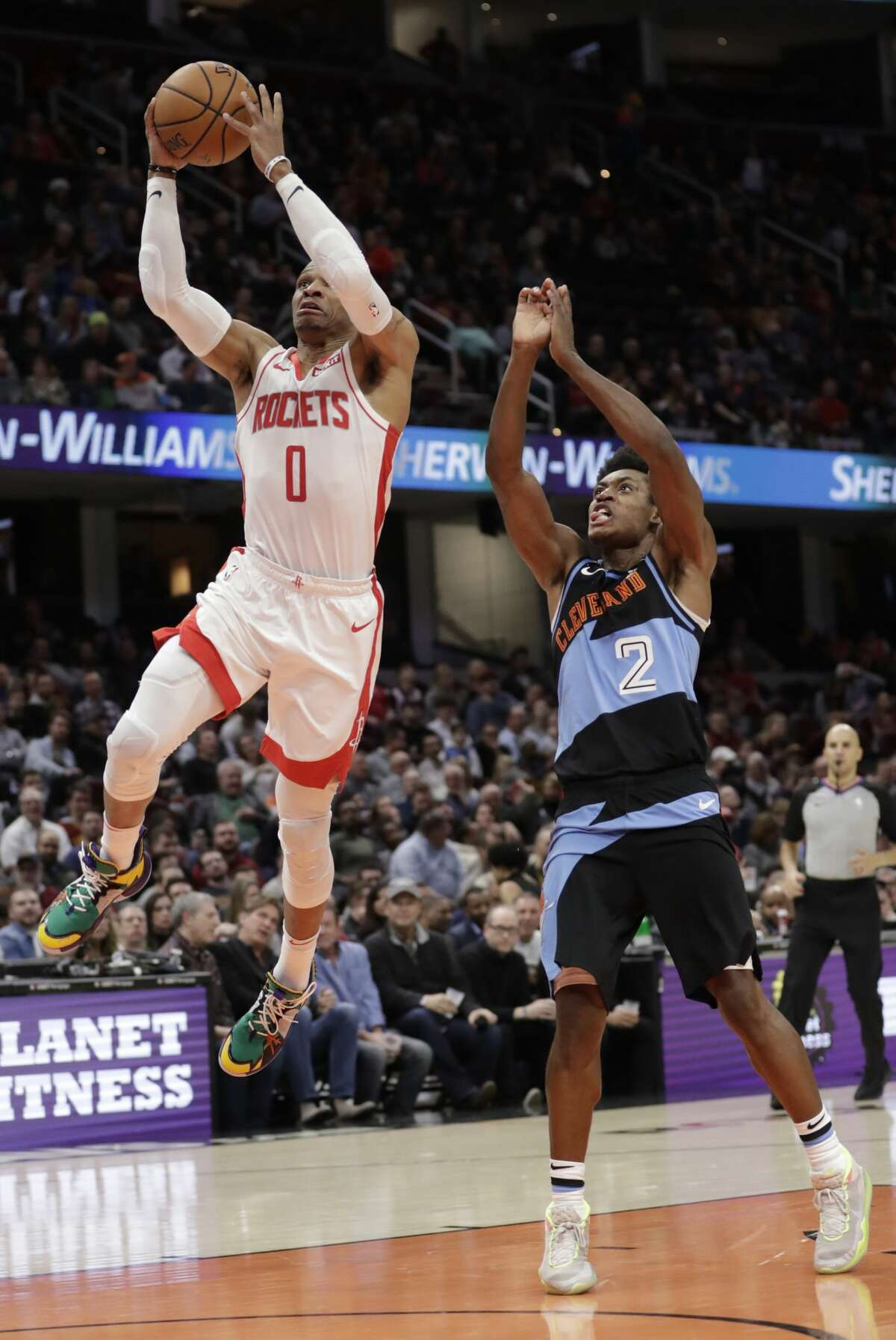 Houston Rockets' Russell Westbrook (0) drives to the basket against Cleveland Cavaliers' Collin Sexton (2) in the second half of an NBA basketball game, Wednesday, Dec. 11, 2019, in Cleveland. (AP Photo/Tony Dejak)
