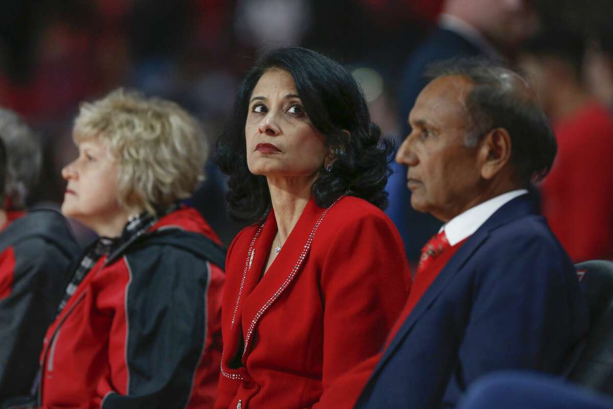 Renu Khator, chancellor of the University of Houston System and president of the University of Houston looks at the big screen during the second half of an NCAA basketball game at Fertitta Center Wednesday, Dec. 4, 2019, in Houston.