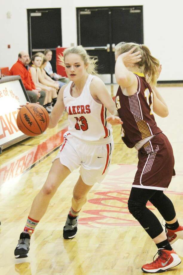 Bear Lake's Bella Leffew dribbles past a defender Wednesday during the Lakers' loss to Mason County Eastern. Photo: Dylan Savela/News Advocate