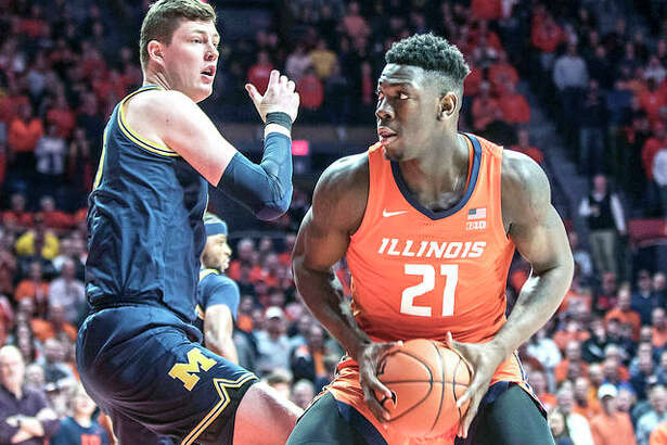 Illinois' Kofi Cockburn (21) looks to shoot as Michigan's Jon Teske (15) defends in the first half of Wednesday nght's game in Champaign at State Farm center.