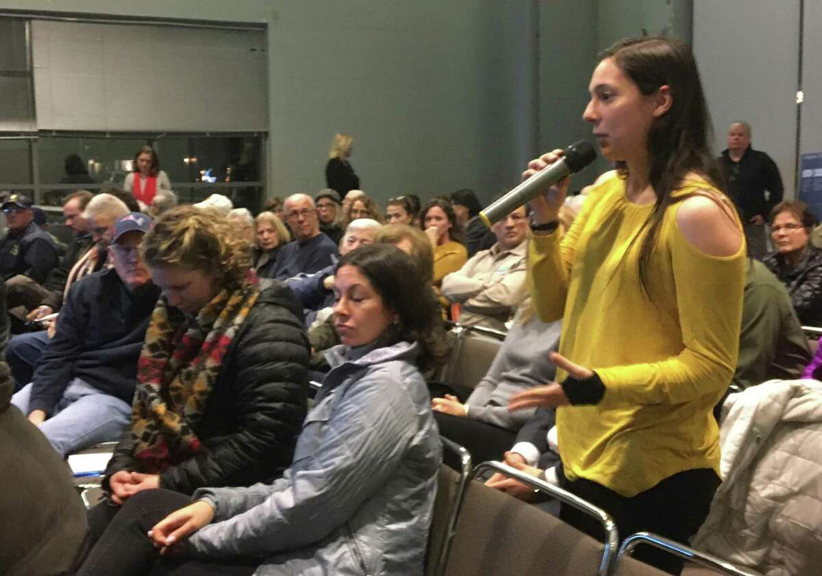Angelina Carnevale, who has lived across from the Tweed Airport in a house on South End Road for 5 years, speaks on Wednesday, Dec. 11, 2019 at the first of two public meetings on Tweed New Haven Regional Airport's upcoming master plan update.