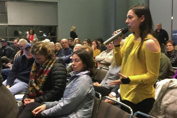 Angelina Carnevale, who has lived across from the Tweed Airport in a house on South End Road for 5 years, speaks on Wednesday, Dec. 11, 2019 at the first of two public meetings on Tweed New Haven Regional Airport's upcoming master plan update. A second meeting will take place on Thursday, Dec. 12 at 6:30 p.m. at the East Haven Senior Center.