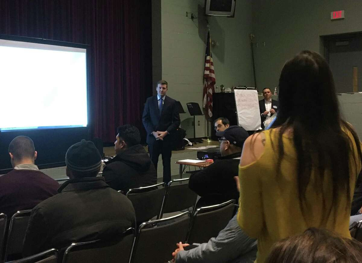Tweed New Haven Airport Authority Executive Director Sean Scanlon, center, answers a question from South End Road resident Angelina Carnevale of New Haven at the first of two public meetings on Tweed's upcoming master plan update on Wednesday, Dec. 11, 2019.