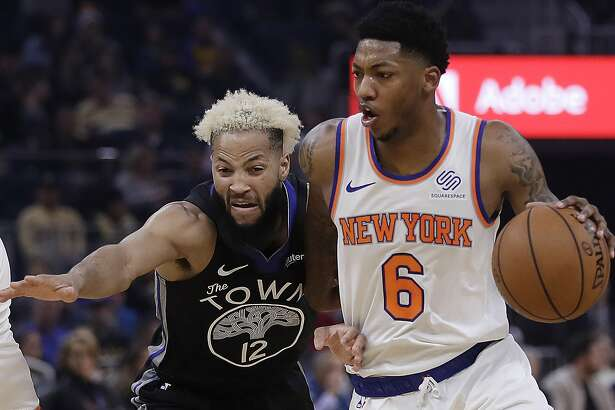 New York Knicks' Elfrid Payton, right, drives the ball against Golden State Warriors' Ky Bowman (12) in the first half of an NBA basketball game, Wednesday, Dec. 11, 2019, in San Francisco. (AP Photo/Ben Margot)
