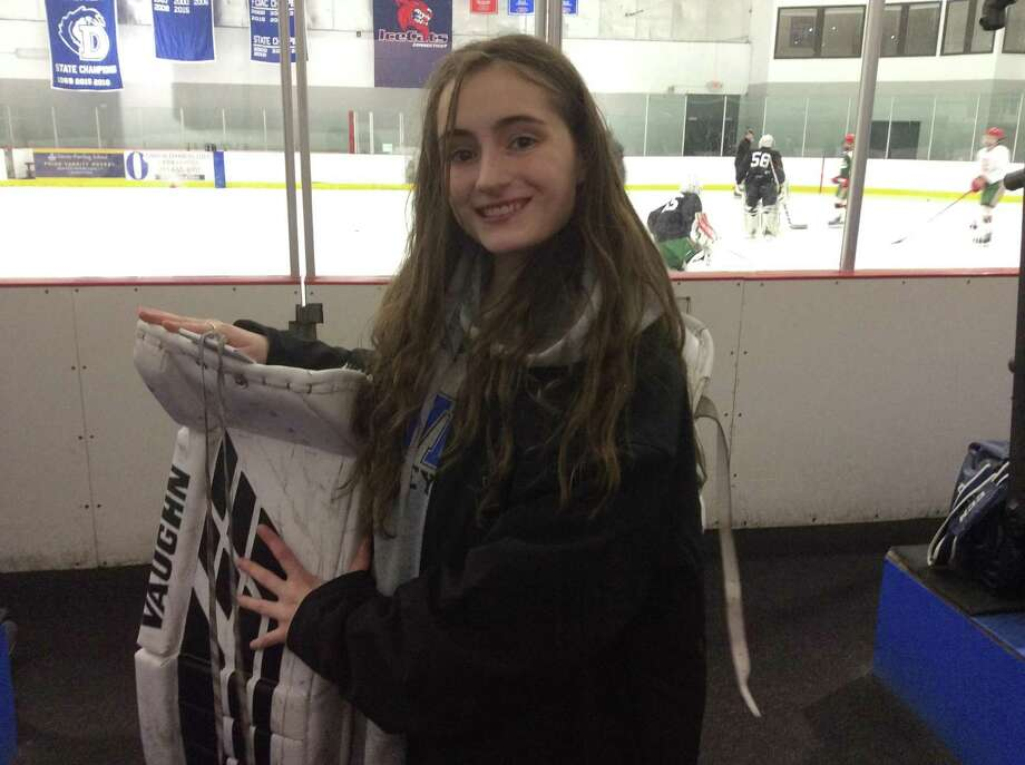 Darien sophomore goalie Ella Whitticom made 15 saves in the Blue Wave's 2-0 win vs. Greenwich at the Darien Ice House on Wednesday. Photo: David Fierro /Hearst Connecticut Media