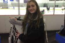 Darien sophomore goalie Ella Whitticom made 15 saves in the Blue Wave's 2-0 win vs. Greenwich at the Darien Ice House on Wednesday.