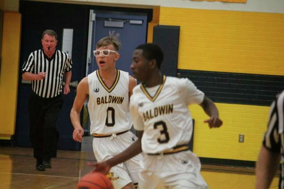 Baldwin's Carmelo Lindsey (3) brings the ball down the court Tuesday with Aveon Hobbs (0). (Star photo/John Raffel)