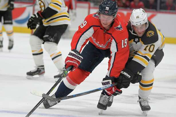 Capitals center Nicklas Backstrom races Bruins left wing Anders Bjork to the puck in the third period Wednesday in Washington.