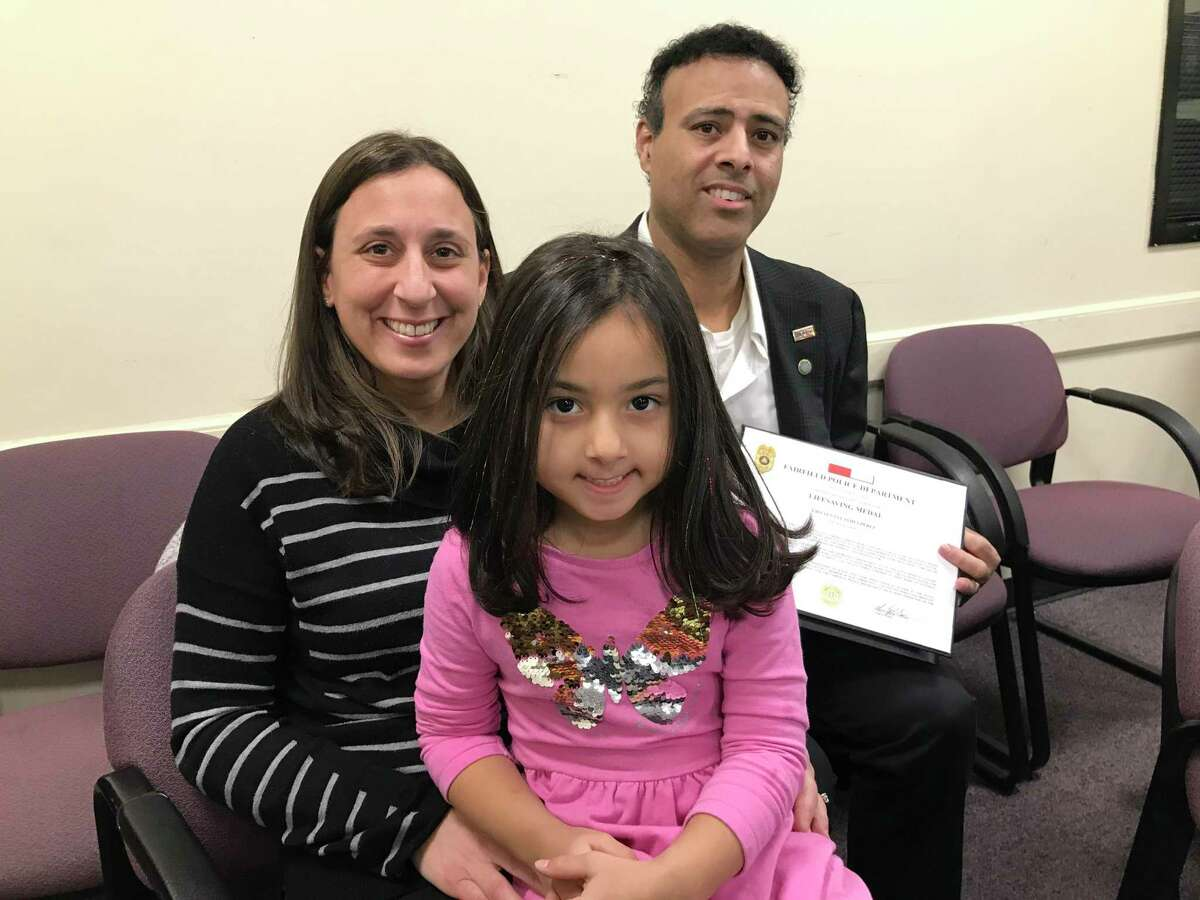 Police Lieutenant James Perez was honored by the town of Fairfield for saving a heart attack patient's life. He's shown here with his wife, Christine, and daughter, Erin.