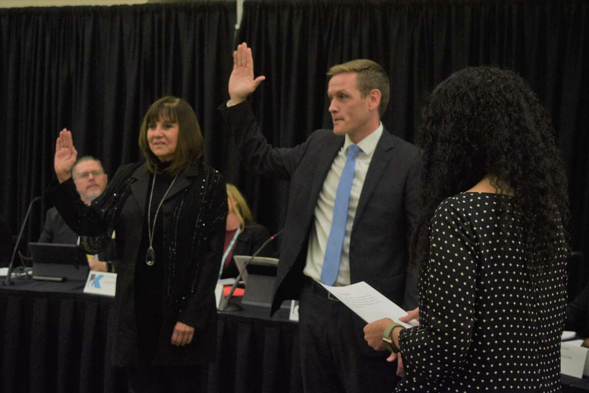 Robert Ellis, new board member in position 7, and Cathy Arellano, reelected position 6, took their oaths of office to the Klein ISD board of trustees during the regular board meeting on Dec. 9.