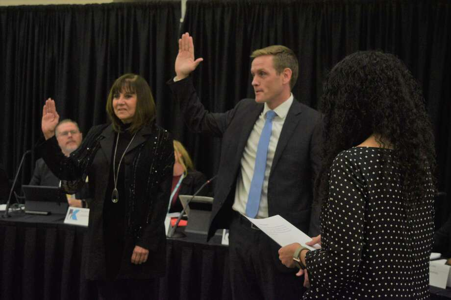 Robert Ellis, new board member in position 7, and Cathy Arellano, reelected position 6, took their oaths of office to the Klein ISD board of trustees during the regular board meeting on Dec. 9. Photo: Chevall Pryce
