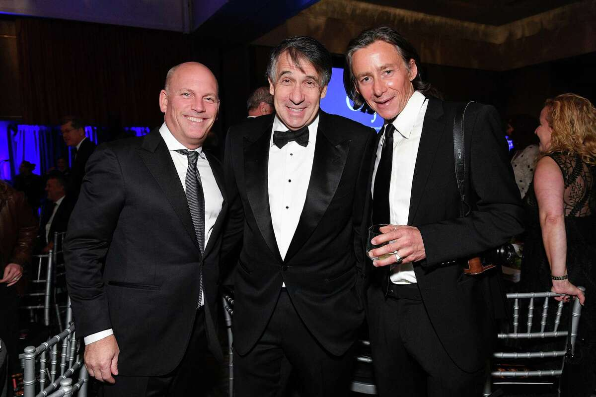 Getty Images CEO Craig Peters, left, Getty Images co-founder and Chairman Jonathan Klein, and photojournalist Spencer Platt attend the Committee to Protect Journalists' 29th Annual International Press Freedom Awards on Nov. 21, 2019, in New York.