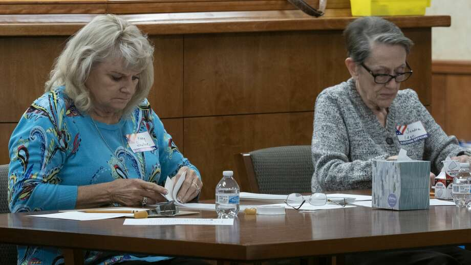 Mary Smelser and Sandra Edge, election volunteers, manually count ballots as they begin the process of manually counting each ballot to verify a total on Thursday, Dec. 12, 2019. Photo: Tim Fischer/Midland Reporter-Telegram