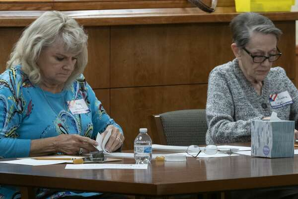 Mary Smelser and Sandra Edge, election volunteers, manually count ballots 12/12/19 morning as they begin the process of manually counting each ballot to verify a total. Tim Fischer/Reporter-Telegram