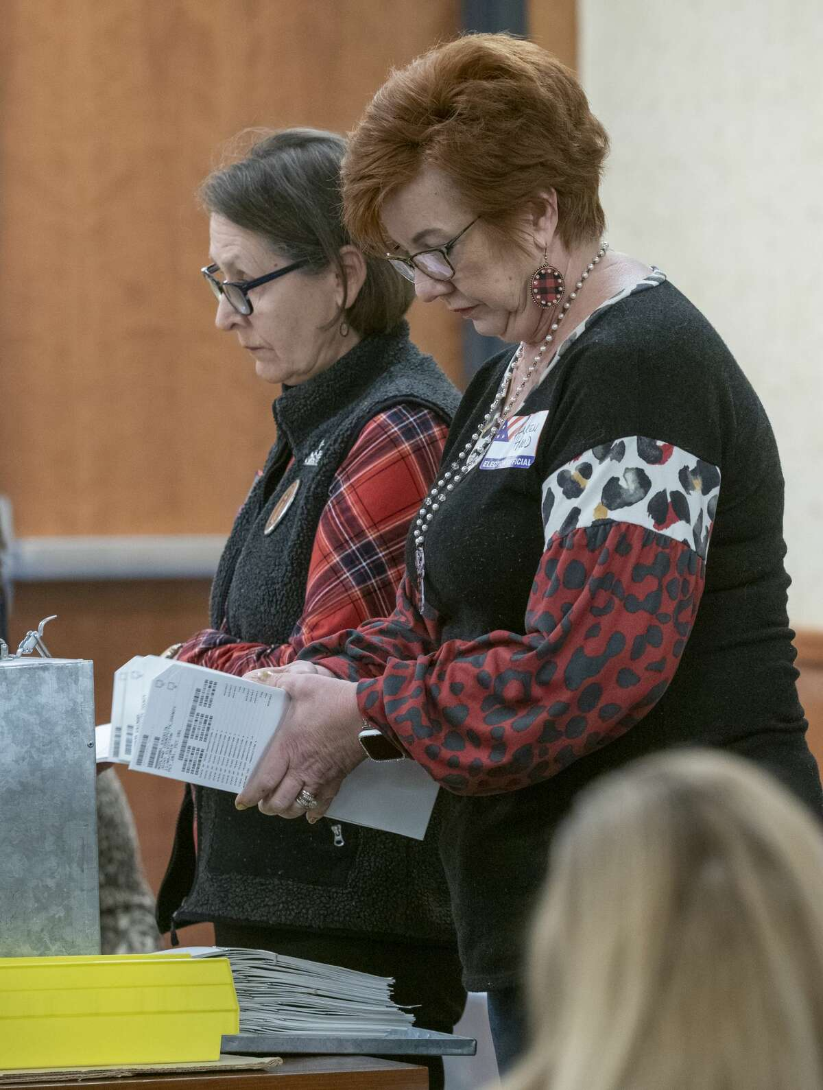 JoAnn Sulak and Karen Hood, election volunteers, manually count ballots as they begin the process of manually counting each ballot to verify a totalon Thursday, Dec. 12, 2019.