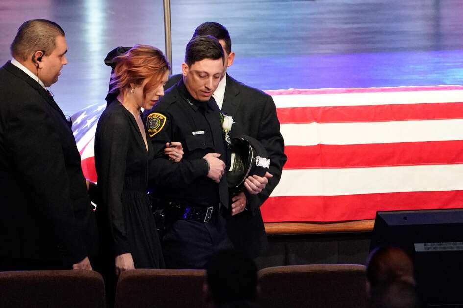 Bethany Elise Brewster is escorted into the church sanctuary for the funeral of her husband, Houston Police Sgt. Christopher Brewster, held at Grace Church Houston, 14505 Gulf Freeway, Thursday, Dec. 12, 2019. Brewster, 32, was gunned down Saturday evening while responding to a domestic violence call in Magnolia Park. Police arrested 25-year-old Arturo Solis that night in the shooting death. Solis faces capital murder charges.