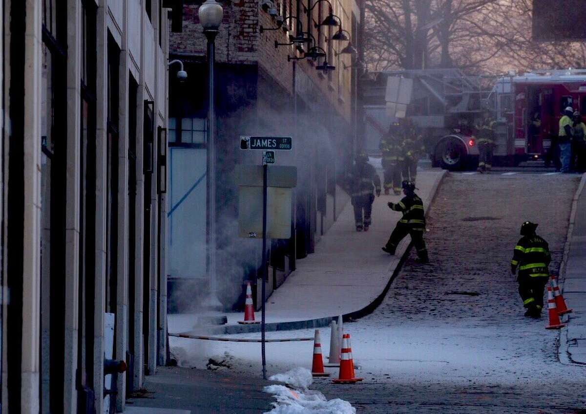City work crews, firefighters and police gather near where a gas leak in a grassy patch between James Street and Maiden Lane in Albany caused a gas leak and prompted the evacuation of several buildings around downtown.